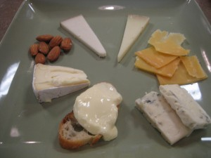 From bottom clockwise: Crescenza, Nettle Meadow Kunik, Tomme Dolce, Abbaye de Belloc, Gouda, Big Woods Blue